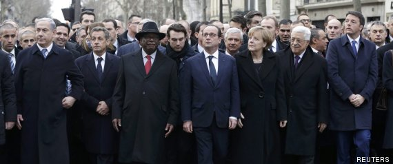 French President Hollande is surrounded by head of states as they attend the solidarity march in the streets of Paris