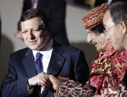 European Commission President Barroso shakes hands with Libya's leader Gaddafi before a dinner at the G8 summit in L'Aquila